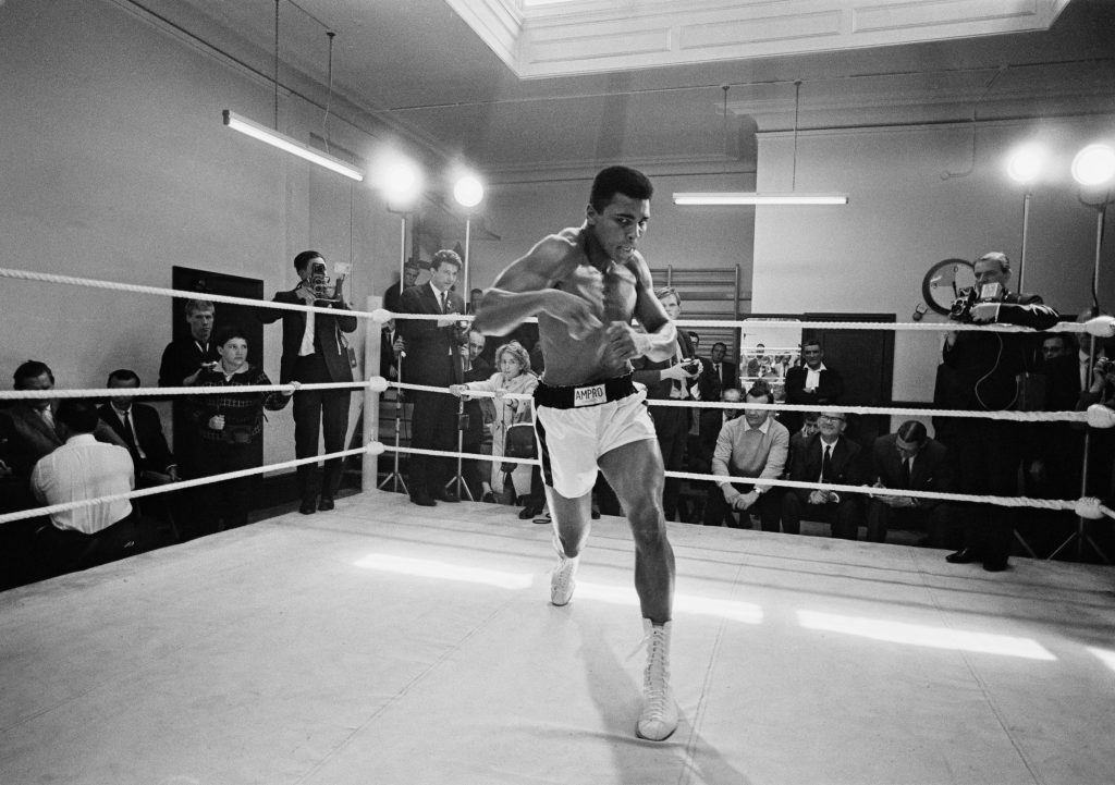 American heavyweight boxer Muhammad Ali throws bare-handed punches in the ring while in training for his fight against Brian London, London, England, August 1966. (Photo by R. McPhedran/Hulton Archive/Getty Images)